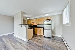 Photo 7: 201 315 9A Street NW in Calgary: Sunnyside Apartment for sale : MLS®# A1035488