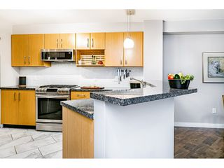 """Photo 8: 309 300 KLAHANIE Drive in Port Moody: Port Moody Centre Condo for sale in """"TIDES"""" : MLS®# R2518443"""