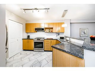 """Photo 11: 309 300 KLAHANIE Drive in Port Moody: Port Moody Centre Condo for sale in """"TIDES"""" : MLS®# R2518443"""