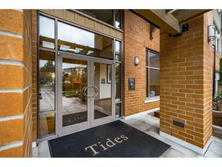 """Photo 1: 309 300 KLAHANIE Drive in Port Moody: Port Moody Centre Condo for sale in """"TIDES"""" : MLS®# R2518443"""
