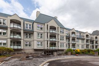 "Photo 1: 206 99 BEGIN Street in Coquitlam: Maillardville Condo for sale in ""Le Chateau"" : MLS®# R2403917"