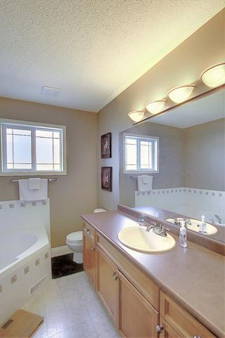 Photo 13: 121 Country Hills Gardens NW in Calgary: Country Hills Row/Townhouse for sale : MLS®# A1057496