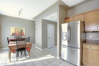Photo 6: 121 Country Hills Gardens NW in Calgary: Country Hills Row/Townhouse for sale : MLS®# A1057496
