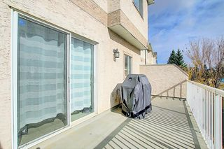 Photo 9: 121 Country Hills Gardens NW in Calgary: Country Hills Row/Townhouse for sale : MLS®# A1057496