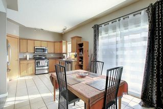 Photo 7: 121 Country Hills Gardens NW in Calgary: Country Hills Row/Townhouse for sale : MLS®# A1057496