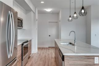 Photo 3: 304 19621 40 Street SE in Calgary: Seton Apartment for sale : MLS®# C4295598