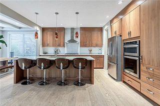 Photo 9: 76 Quarry Garden SE in Calgary: Douglasdale/Glen Detached for sale : MLS®# C4268088
