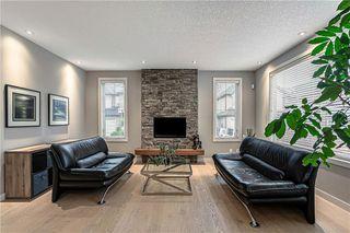 Photo 7: 76 Quarry Garden SE in Calgary: Douglasdale/Glen Detached for sale : MLS®# C4268088