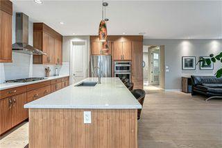 Photo 11: 76 Quarry Garden SE in Calgary: Douglasdale/Glen Detached for sale : MLS®# C4268088