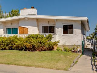 Photo 1: 2418 98 Avenue SW in Calgary: Palliser Duplex for sale : MLS®# A1025542