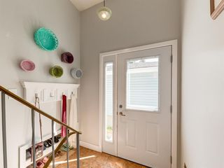Photo 2: 2418 98 Avenue SW in Calgary: Palliser Duplex for sale : MLS®# A1025542
