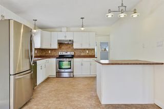 Photo 8: 812 Canfield Way SW in Calgary: Canyon Meadows Semi Detached for sale : MLS®# A1049483