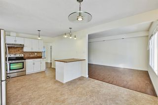 Photo 9: 812 Canfield Way SW in Calgary: Canyon Meadows Semi Detached for sale : MLS®# A1049483