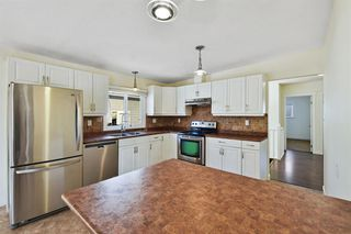 Photo 7: 812 Canfield Way SW in Calgary: Canyon Meadows Semi Detached for sale : MLS®# A1049483