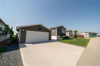 Photo 2: 23 SUNSET Crescent in MacDonald (town): R08 Condominium for sale : MLS®# 202013702