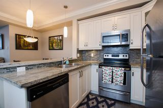 """Photo 2: 421 13897 FRASER Highway in Surrey: Whalley Condo for sale in """"EDGE"""" (North Surrey)  : MLS®# R2422441"""