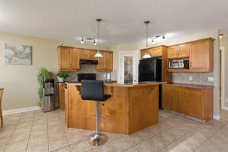 Photo 7: 228 BRIDLEWOOD Common SW in Calgary: Bridlewood Detached for sale : MLS®# A1034848