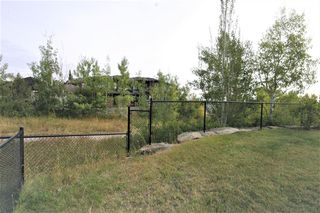 Photo 12: 36 Coulee Park SW in Calgary: Cougar Ridge Detached for sale : MLS®# A1036278