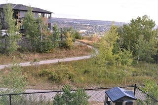 Photo 11: 36 Coulee Park SW in Calgary: Cougar Ridge Detached for sale : MLS®# A1036278