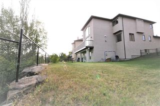 Photo 9: 36 Coulee Park SW in Calgary: Cougar Ridge Detached for sale : MLS®# A1036278