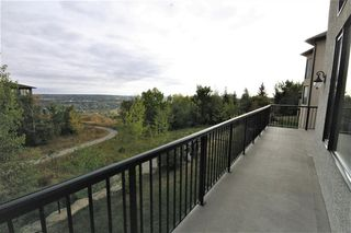 Photo 6: 36 Coulee Park SW in Calgary: Cougar Ridge Detached for sale : MLS®# A1036278