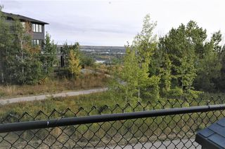 Photo 10: 36 Coulee Park SW in Calgary: Cougar Ridge Detached for sale : MLS®# A1036278