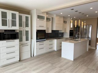 Photo 15: 36 Coulee Park SW in Calgary: Cougar Ridge Detached for sale : MLS®# A1036278