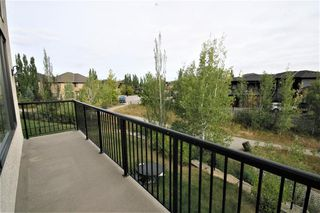 Photo 7: 36 Coulee Park SW in Calgary: Cougar Ridge Detached for sale : MLS®# A1036278