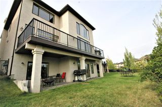 Photo 8: 36 Coulee Park SW in Calgary: Cougar Ridge Detached for sale : MLS®# A1036278