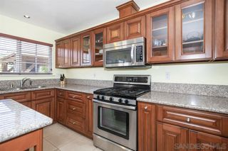 Photo 6: PARADISE HILLS House for sale : 4 bedrooms : 6529 Lockford Ave in San Diego