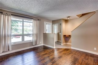 Photo 3: 194 WOODMONT Terrace SW in Calgary: Woodbine Row/Townhouse for sale : MLS®# C4306150