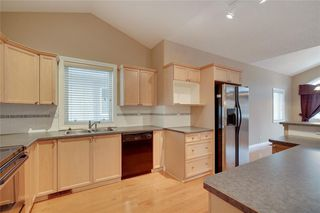 Main Photo: 212 SIMCOE Place SW in Calgary: Signal Hill Semi Detached for sale : MLS®# C4293353