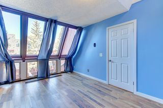 Photo 7: 16 828 Coach Bluff Crescent SW in Calgary: Coach Hill House for sale