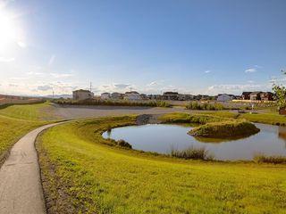 Photo 32: 116 HEARTLAND Way: Cochrane Detached for sale : MLS®# C4305625