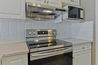 Photo 9: 71 EDGERIDGE Terrace NW in Calgary: Edgemont Duplex for sale : MLS®# A1022795