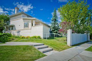 Photo 2: 71 EDGERIDGE Terrace NW in Calgary: Edgemont Duplex for sale : MLS®# A1022795