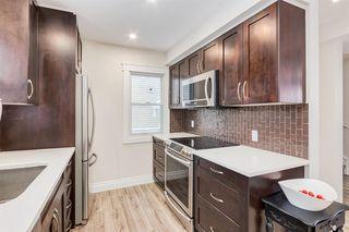 Photo 16: 2290 PASSCHENDAELE Avenue SW in Calgary: Garrison Woods Semi Detached for sale : MLS®# A1030102