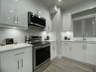 Photo 4: 4985 MOSS Street in Vancouver: Collingwood VE 1/2 Duplex for sale (Vancouver East)  : MLS®# R2511824