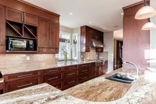 Photo 9: 33 Spring Valley Lane SW in Calgary: Springbank Hill Detached for sale : MLS®# A1047660
