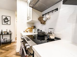 """Photo 6: 213 555 W 14TH Avenue in Vancouver: Fairview VW Condo for sale in """"Cambridge Place"""" (Vancouver West)  : MLS®# R2448193"""