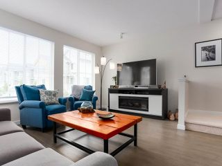 """Photo 2: 110 5550 ADMIRAL Way in Ladner: Neilsen Grove Townhouse for sale in """"FAIRWYNDS AT HAMPTON COVE"""" : MLS®# R2466448"""