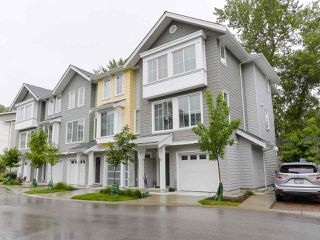 """Photo 1: 110 5550 ADMIRAL Way in Ladner: Neilsen Grove Townhouse for sale in """"FAIRWYNDS AT HAMPTON COVE"""" : MLS®# R2466448"""