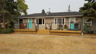 Photo 1: 6304 Bowview Road NW in Calgary: Bowness Duplex for sale : MLS®# A1038696