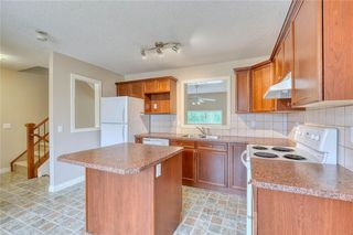 Photo 13: 66 Crystal Shores Cove: Okotoks Row/Townhouse for sale : MLS®# C4305435