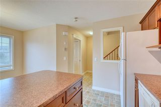 Photo 19: 66 Crystal Shores Cove: Okotoks Row/Townhouse for sale : MLS®# C4305435