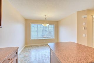 Photo 14: 66 Crystal Shores Cove: Okotoks Row/Townhouse for sale : MLS®# C4305435