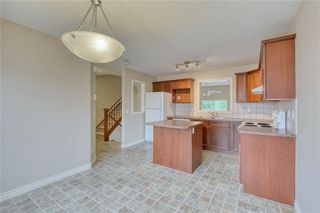Photo 12: 66 Crystal Shores Cove: Okotoks Row/Townhouse for sale : MLS®# C4305435