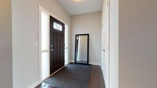 Photo 2: 1934 BAYWATER Alley SW: Airdrie Semi Detached for sale : MLS®# A1025806