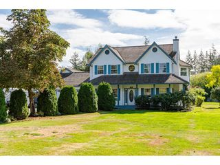 "Photo 1: 25120 57 Avenue in Langley: Salmon River House for sale in ""Strawberry Hills"" : MLS®# R2500830"