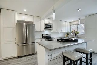 Photo 2: 18 23 GLAMIS Drive SW in Calgary: Glamorgan Row/Townhouse for sale : MLS®# C4293162